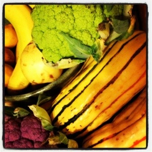 Pears and bananas gone by with new Delicata squash and purple and green cauliflower