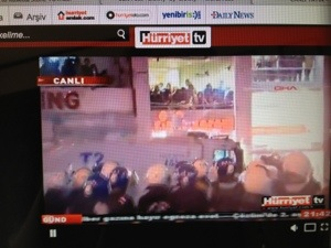 This shows police gassing people in and near the Simit Sarayi (Simit Palace, a sort of bagel-like shop) where M. and I usually stop for a snack before walking Istiklal Caddesi. (Image is screen capture by Liz Cameron)
