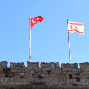Flags from the Turkish Republic next to that of Northern Cyprus in Kyrenia's castle - two peas in a pod? (Image by Liz Cameron)